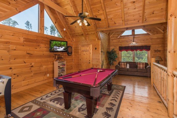 Pool table in the loft at Happy Daze, a 2-bedroom Pigeon Forge cabin rental