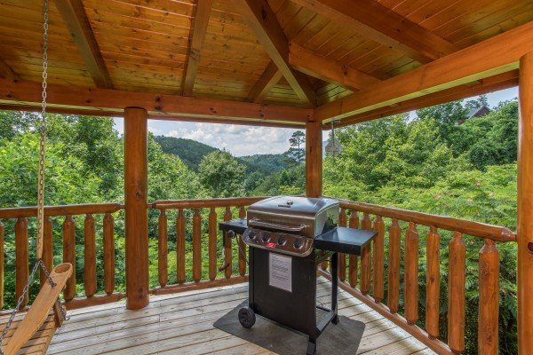 Propane grill on a covered deck at Happy Daze, a 2-bedroom Pigeon Forge cabin rental