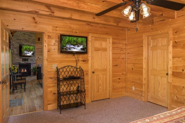 Bedroom with a bookshelf and TV at Happy Daze, a 2-bedroom Pigeon Forge cabin rental