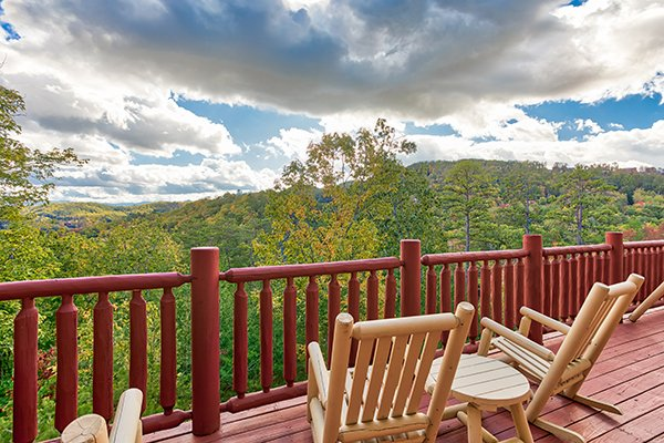 Rocking chairs overlooking the mountain view at Mountain Wonderland, a 3 bedroom cabin rental located in Pigeon Forge