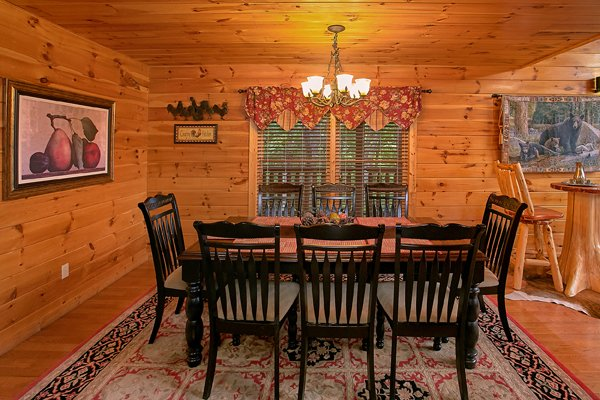 Dining space for eight at Mountain Wonderland, a 3 bedroom cabin rental located in Pigeon Forge