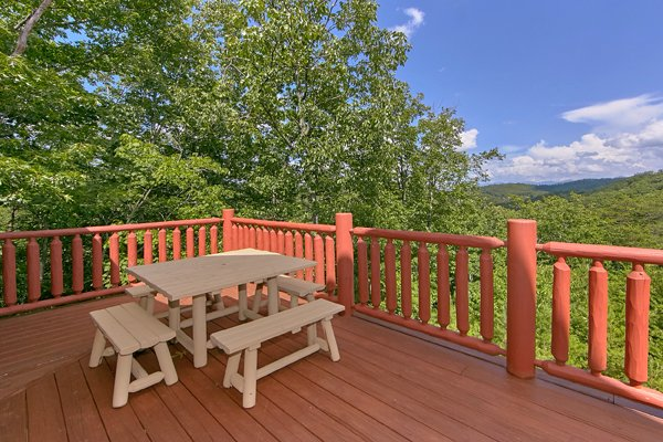 Dining table overlooking the views on the deck at Mountain Wonderland, a 3 bedroom cabin rental located in Pigeon Forge