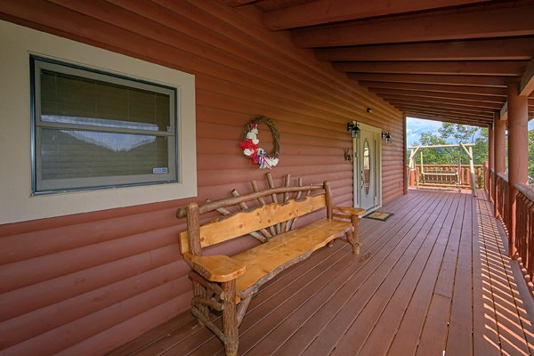 Bench at the front entry at Mountain Wonderland, a 3 bedroom cabin rental located in Pigeon Forge