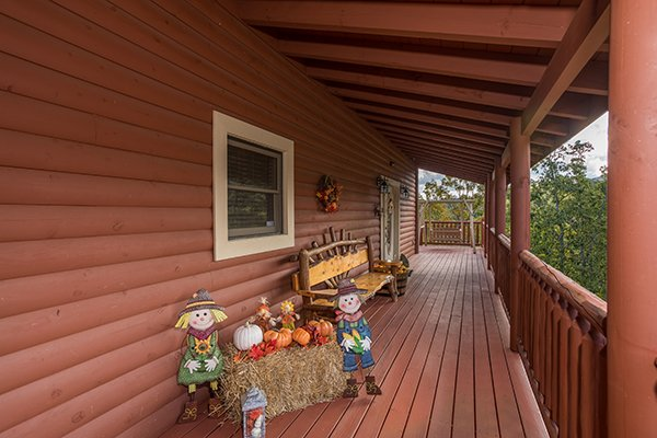 Fall decor on the front porch at Mountain Wonderland, a 3 bedroom cabin rental located in Pigeon Forge