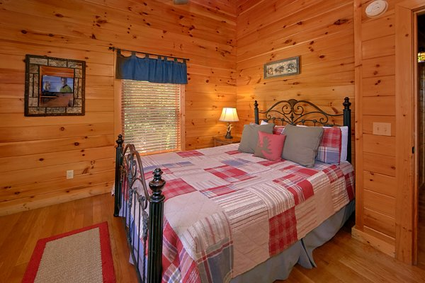 Bedroom on the upper floor at Mountain Wonderland, a 3 bedroom cabin rental located in Pigeon Forge