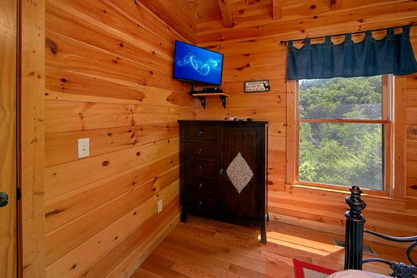 Armoire and tv in a bedroom at Mountain Wonderland, a 3 bedroom cabin rental located in Pigeon Forge