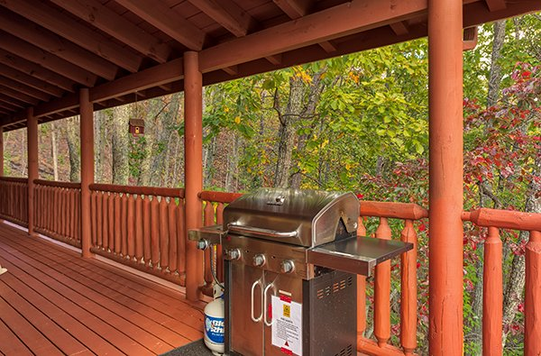 Propane grill on a covered deck at Mountain Wonderland, a 3 bedroom cabin rental located in Pigeon Forge