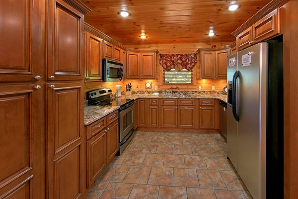 Custom kitchen with stainless appliances at Mountain Wonderland, a 3 bedroom cabin rental located in Pigeon Forge