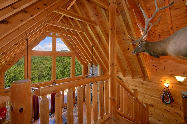 Loft with large windows and natural light at Mountain Wonderland, a 3 bedroom cabin rental located in Pigeon Forge