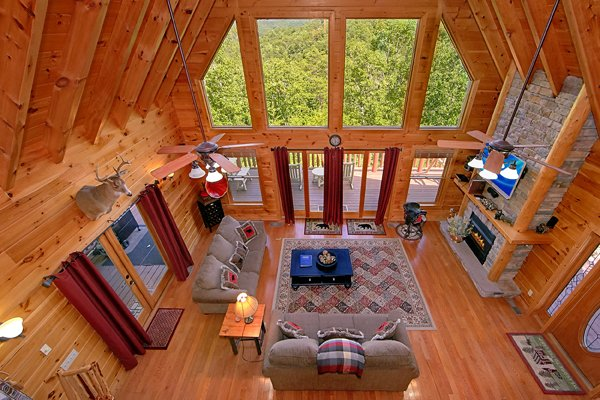 Looking down into the living room from the upper floor at Mountain Wonderland, a 3 bedroom cabin rental located in Pigeon Forge