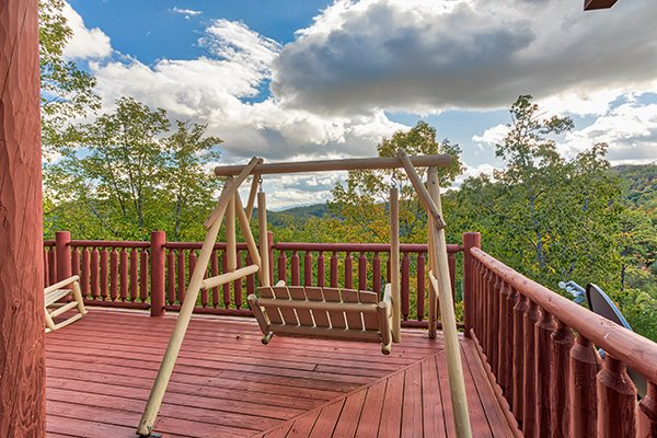 Swing on the deck at Mountain Wonderland, a 3 bedroom cabin rental located in Pigeon Forge