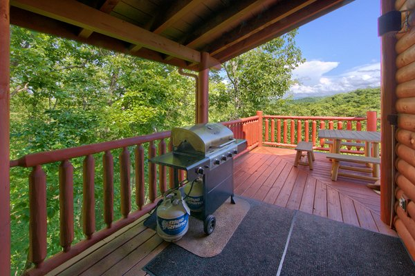 Grill on the covered deck at Mountain Wonderland, a 3 bedroom cabin rental located in Pigeon Forge