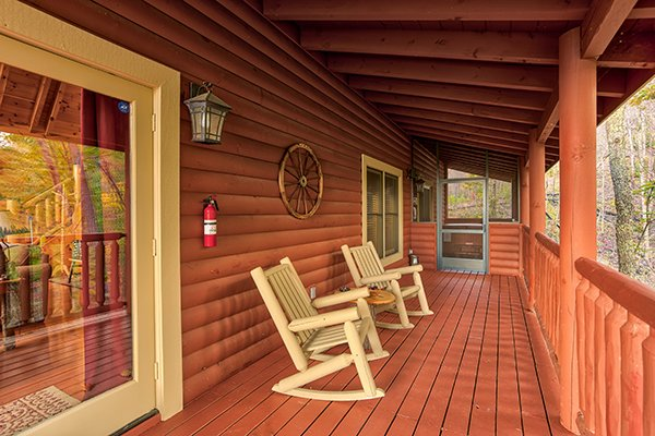 Rocking chairs on a covered porch at Mountain Wonderland, a 3 bedroom cabin rental located in Pigeon Forge