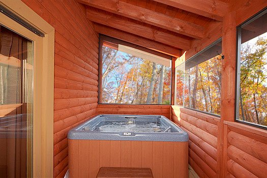 Screened in deck with hot tub at Mountain Wonderland, a 3 bedroom cabin rental located in Pigeon Forge