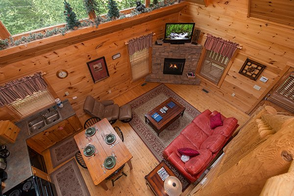 Looking down into the living room at True Love, a 1 bedroom cabin rental located in Gatlinburg