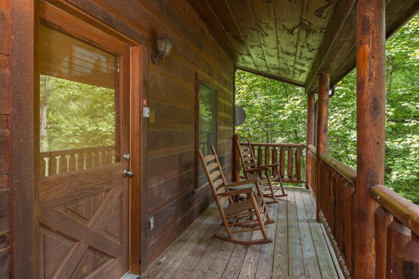 Covered front porch with rocking chairs at True Love, a 1 bedroom cabin rental located in Gatlinburg