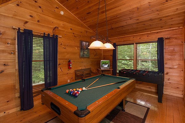 Pool table in the game loft at True Love, a 1 bedroom cabin rental located in Gatlinburg