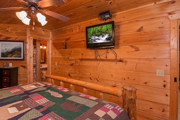 King bedroom with a TV at True Love, a 1 bedroom cabin rental located in Gatlinburg