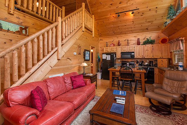 Living, dining, and kitchen at True Love, a 1 bedroom cabin rental located in Gatlinburg