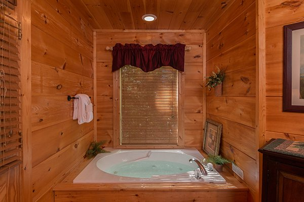 Jacuzzi in the king bedroom at True Love, a 1 bedroom cabin rental located in Gatlinburg