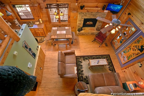 Looking down into the living room from above at Picture Perfect Hideaway, a 2 bedroom cabin rental located in Pigeon Forge