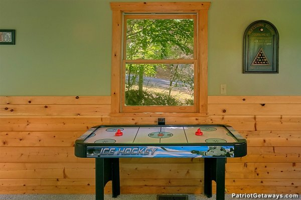 Air hockey table at Picture Perfect Hideaway, a 2 bedroom cabin rental located in Pigeon Forge