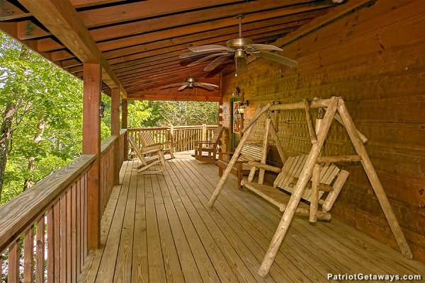Sing on a covered deck at Picture Perfect Hideaway, a 2 bedroom cabin rental located in Pigeon Forge