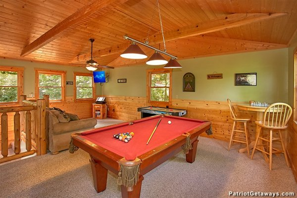 Game loft with pool and foosball at Picture Perfect Hideaway, a 2 bedroom cabin rental located in Pigeon Forge