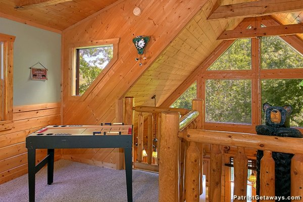 Game table in the loft space at Picture Perfect Hideaway, a 2 bedroom cabin rental located in Pigeon Forge
