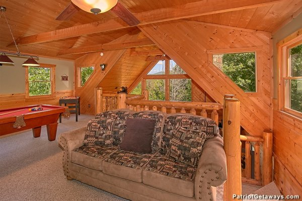 Sleeper sofa in the loft at Picture Perfect Hideaway, a 2 bedroom cabin rental located in Pigeon Forge