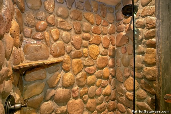 Custom rock shower at Picture Perfect Hideaway, a 2 bedroom cabin rental located in Pigeon Forge