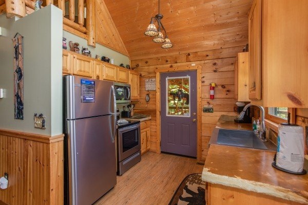 Kitchen with stainless appliances at Picture Perfect Hideaway, a 2 bedroom cabin rental located in Pigeon Forge