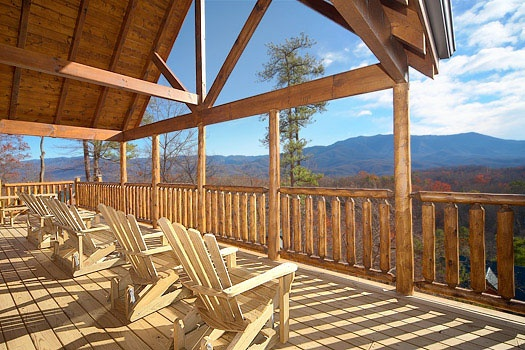 adirondak chairs looking at the smoky mountain from the deck at elk ridge lodge a 4 bedroom cabin rental located in gatlinburg