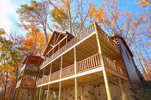 view looking up at the multiple levels of decks of elk ridge lodge a 4 bedroom cabin rental located in gatlinburg
