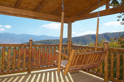 swing on the deck of elk ridge lodge a 4 bedroom cabin rental located in gatlinburg