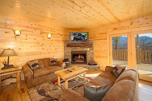 sofa bed in the game room of elk ridge lodge a 4 bedroom cabin rental located in gatlinburg
