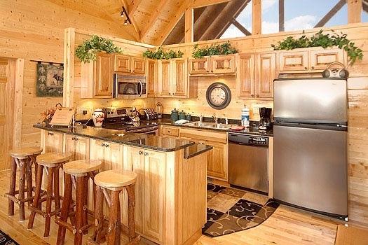 stainless appliances in the kitchen with breakfast bar at elk ridge lodge a 4 bedroom cabin rental located in gatlinburg