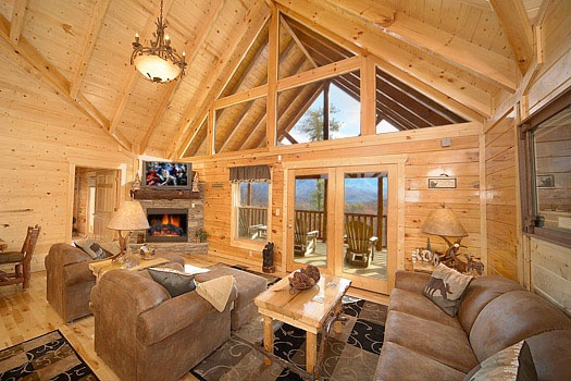 sofa bed in living room with stone fireplace at elk ridge lodge a 4 bedroom cabin rental located in gatlinburg