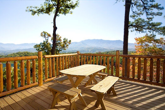 picnic table on the deck at elk ridge lodge a 4 bedroom cabin rental located in gatlinburg