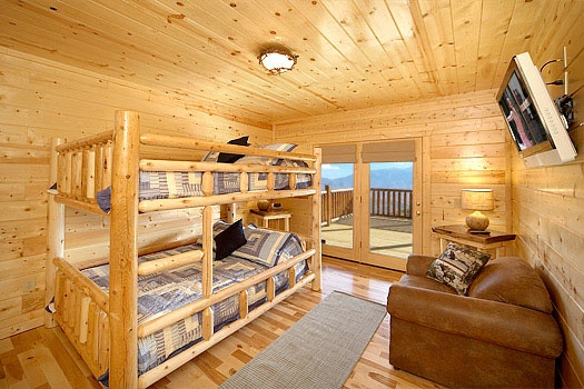 queen bunk beds on the first floor of elk ridge lodge a 4 bedroom cabin rental located in gatlinburg