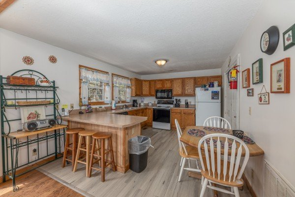 Kitchen and dining space at Bear it All, a 2 bedroom cabin rental located in Sevierville
