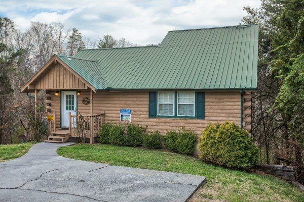 Front exterior view and paved parking at Bear it All, a 2-bedroom cabin rental located in Sevierville