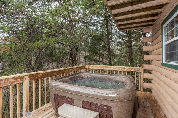 Hot tub on the deck with woods views at Bear it All, a 2-bedroom cabin rental located in Sevierville