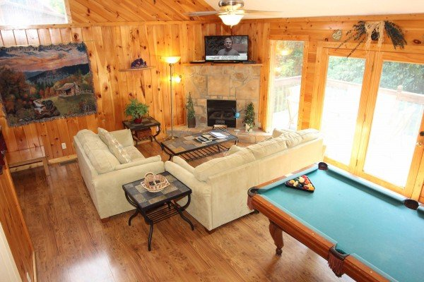 Looking down into the living room from upstairs at Bear it All, a 2-bedroom cabin rental located in Sevierville