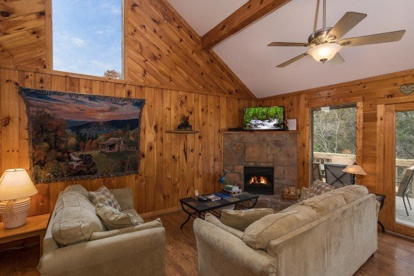Large picture window in the living room at Bear it All, a 2-bedroom cabin rental located in Sevierville