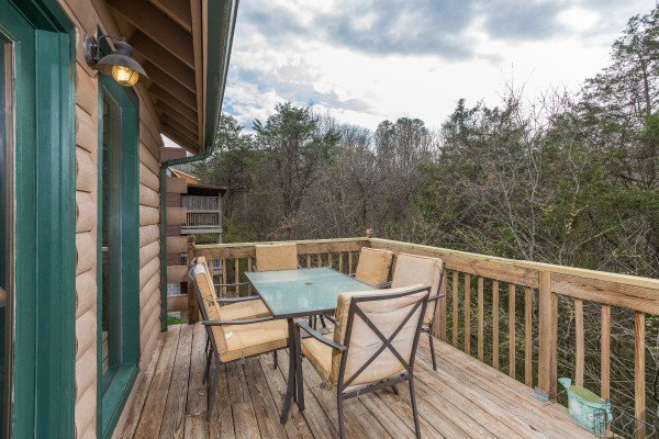 Outdoor dining for six on the deck at Bear it All, a 2-bedroom cabin rental located in Sevierville