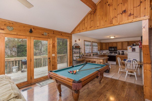 Pool table in the living room at Bear it All, a 2-bedroom cabin rental located in Sevierville