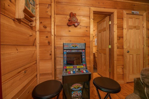 Multigame arcade at Logan's Smoky Den, a 2 bedroom cabin rental located in Pigeon Forge