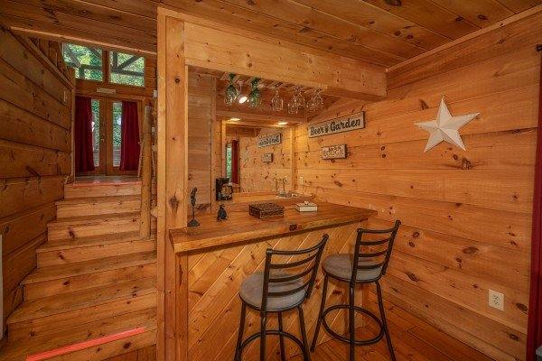 Bar on the lower floor at Logan's Smoky Den, a 2 bedroom cabin rental located in Pigeon Forge