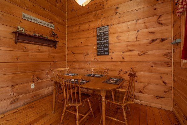 Dining table for four at Logan's Smoky Den, a 2 bedroom cabin rental located in Pigeon Forge